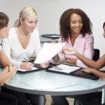 Four Modern Businesswomen In Office Meeting
