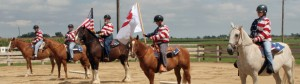 Veterans standing horses with BraveHearts and U.S. flags